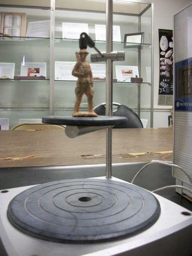 Scanning a lead figurine representing a World War I doughboy recovered at Thomas Jefferson's Poplar Forest.