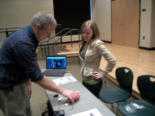 Ashley McCuistion demonstrates digital models and plastic replicas to history teacher James Triesler.