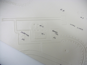 Raised map with Braille showing the Ferry Farm landscape.
