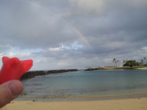 A replica Susquehannock pipe bowl gazes at a Hawaiian rainbow.