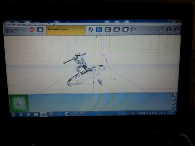 The digital model of an army man as it is forming on the laptop's screen.