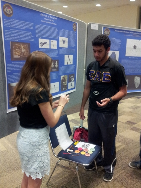 "Mariana Zechini discusses digital and plastic replicas associated with her research poster entitled ""Baculum to the Future"""