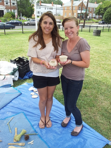 Mariana and Ashley with their ceramic vessels.