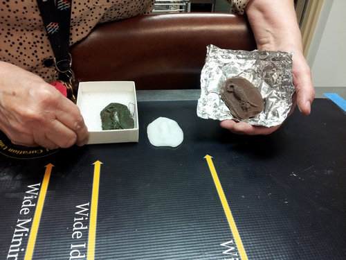 Actual, plastic replica, and chocolate replica of the jeweler's mold.