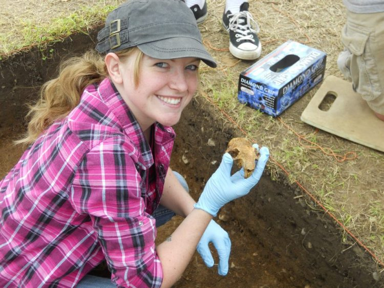 Ashley McCuistion holds the recovered groundhog skull.