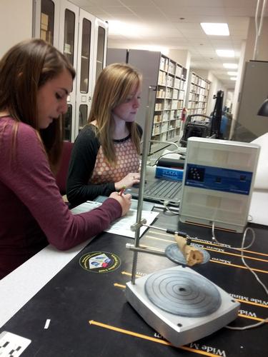 Mariana and Ashley scanning a bone artifact.