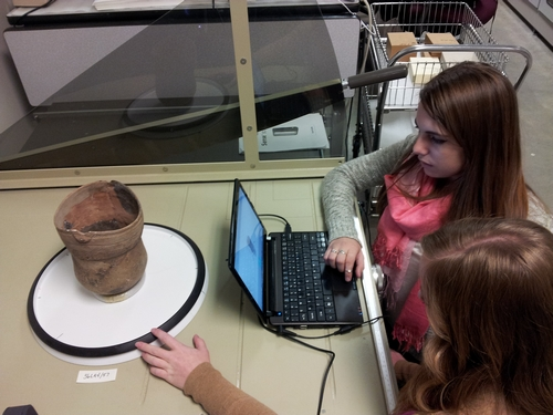 Ashley and Mariana work to scan a vessel with the Sense 3D scanner. The vessel is on a Lazy Susan.