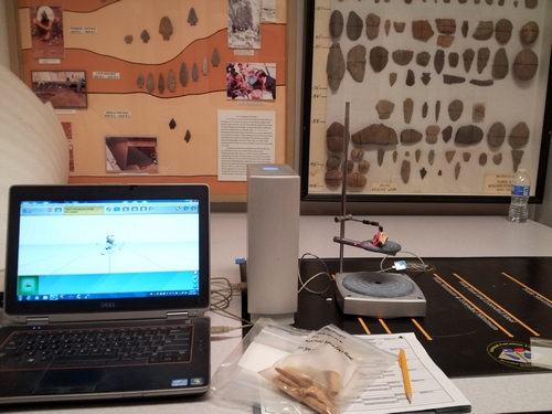 Scanning a worked bone artifact from the Martin site.