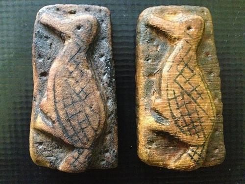 Bird/man replica adjacent to original,