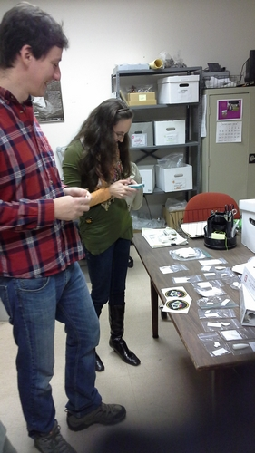 Mike and Tiffany examine printed replicas of artifacts.