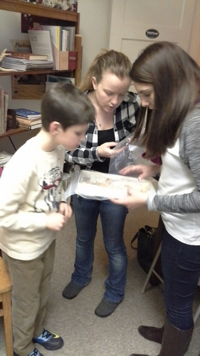 Lowell, Ashley, and Mariana compare the mammal mummy to a opossum skeleton