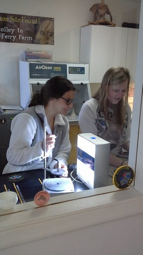 Vivian Hite (left) and Lauren Volkers (right) work on scanning furniture-related Small Finds.