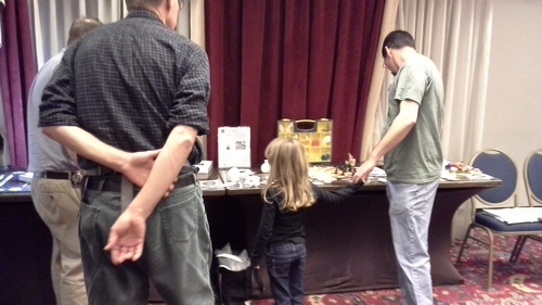 A young attendee expresses interest.