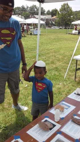 A super-interested kid at Archaeology in the Community's Day of Archaeology festival.
