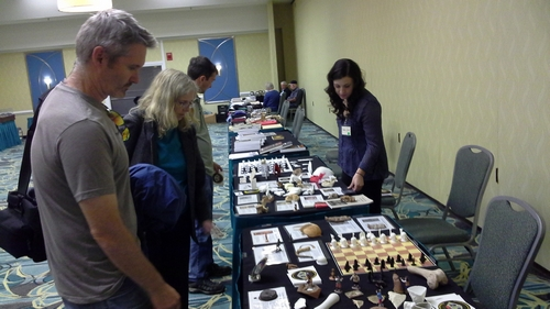 Kaitie Lyford, right, shows artifacts to ASV attendees