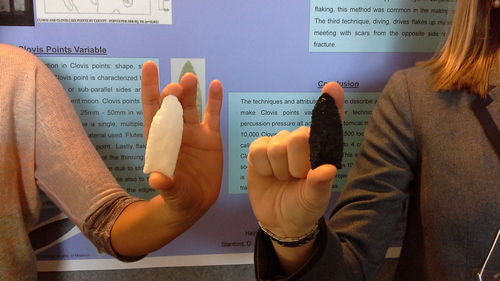 Holding replica Clovis Points