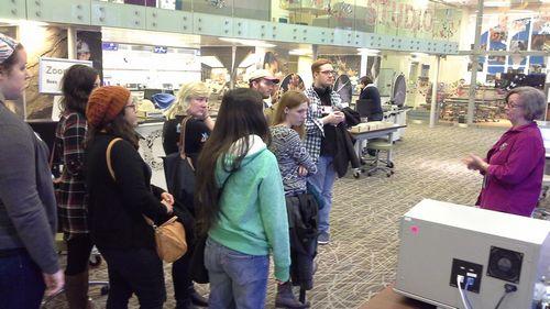 Deborah Hull-Walski, far right, discusses the Q?rius lab.