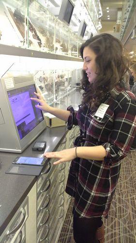 Kaitlyn Lyford examines an object.