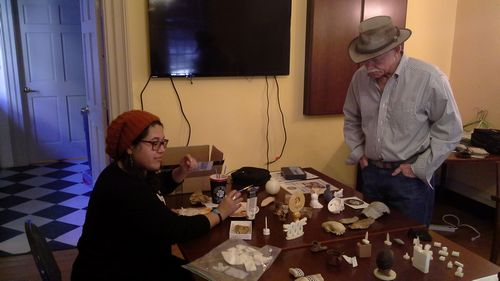 Lucia Aguilar demonstrates her painting skills while Dr. William Kelso of Rediscovery Jamestown looks at her work