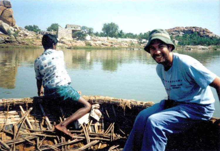 Taking a coracle ride across the Tungabhadra River to Anegundi.