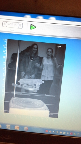 VCL interns Ivana Adzic and Rebecca Bowman look on as the toy blimp is being scanned.
