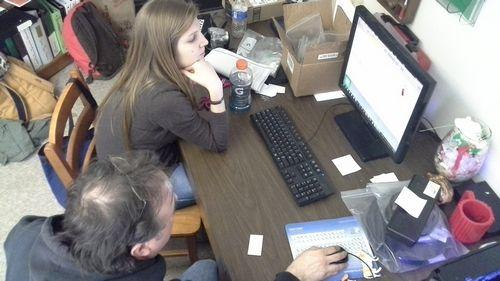 Zoe Rahsman teaches digital model editing to Ray Vodden.