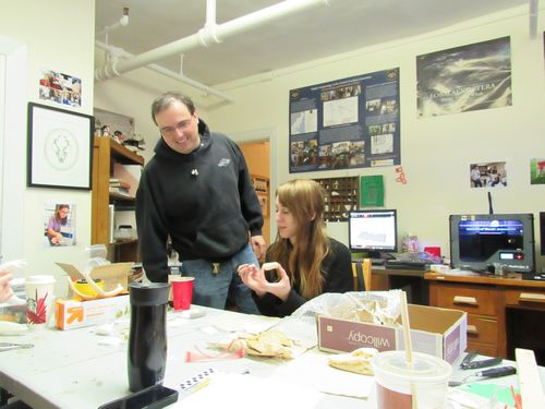 Ray Vodden looks on as Natasha Cote paints a 3D printed replica