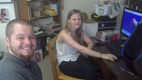 Cagney Guest, left, getting some pointers from VCL Digital Curation Supervisor Lauren Volkers