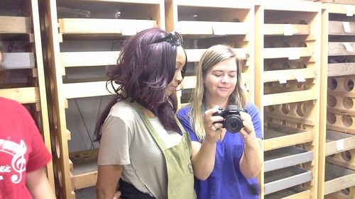 Current intern Michelle Taylor, left, discusses artifact photography with former intern Lucy Treado in Jamestown's archaeology lab.