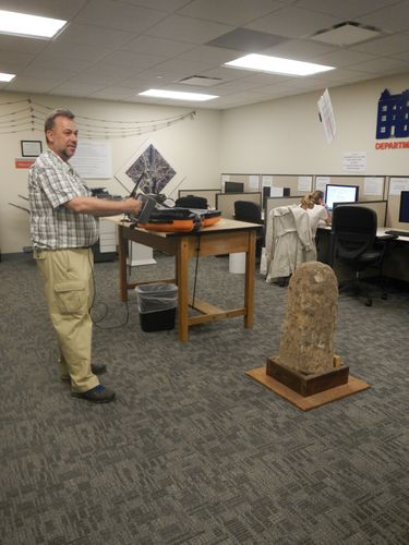 Scanning the boundary stone in the D.C. Surveyors Office.  Photograph courtesy of Chardé Reid.