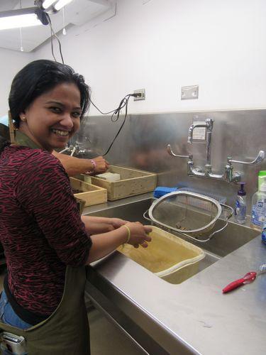 Current intern Shonalika Mondal helps wash artifacts in the Jamestown lab.