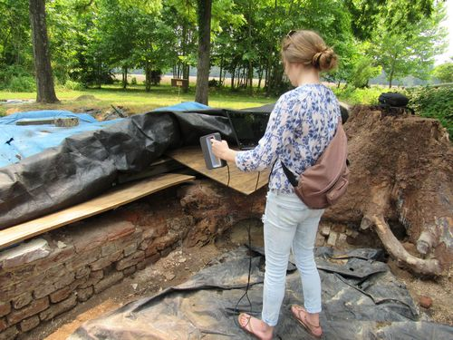 Zoe Rahsman uses the Sense 3D scanner to document part of a brick wall at the Fairfield Plantation.