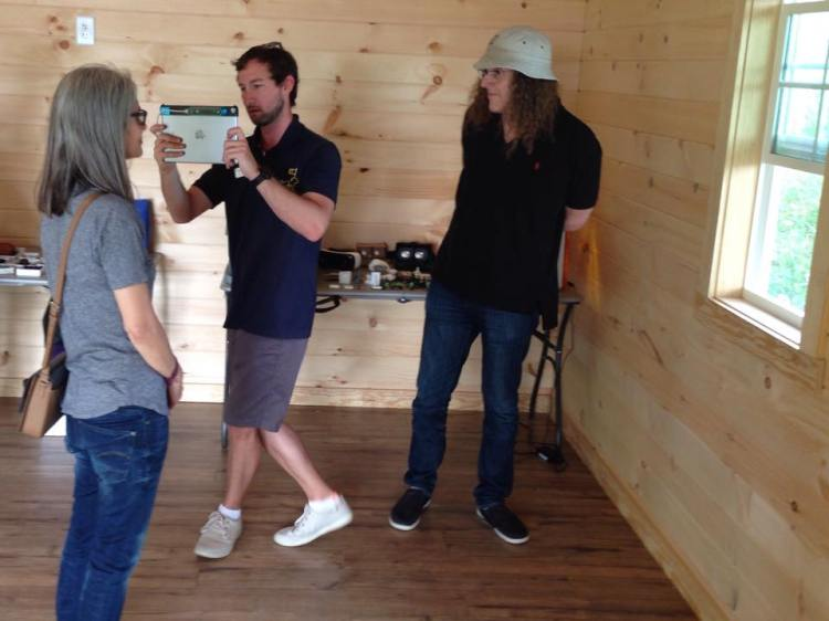 Weird Al looks on as Jamestown's Jeff Aronowitz scans a family member in the new Ed Shed.