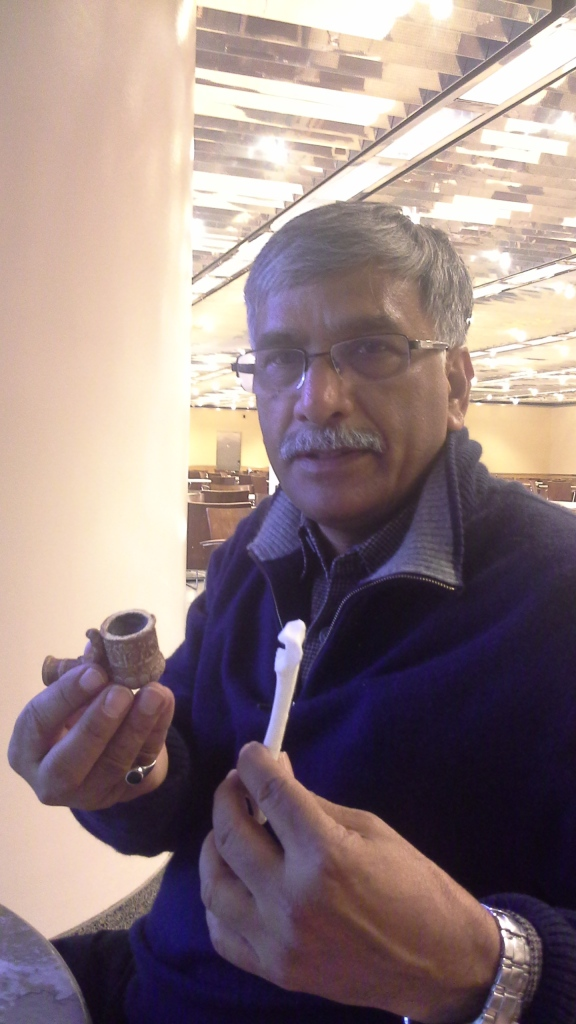 Sitting in the National Gallery of Art, Vinod examines some 3D printed artifact replicas.