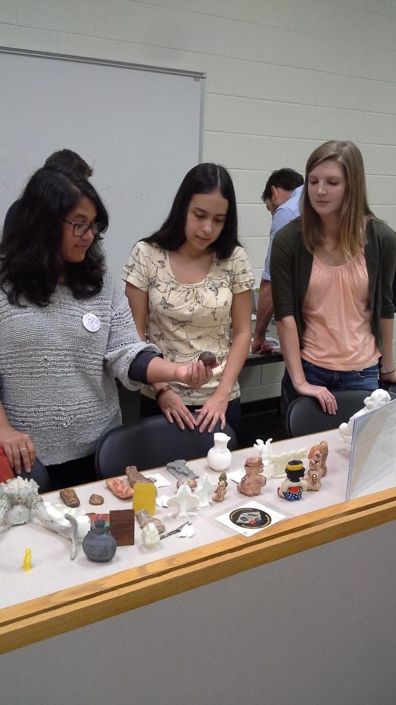 VAST members examine 3D printed artifacts