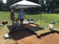 Cameron Walker talks soils and stratigraphy with the George Washington Foundation's Laura Galke.