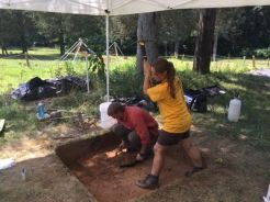 Shane trowels while Brittany gets serious about the soil.