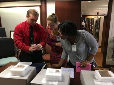 Matt, Kendall, and Alexis examine cuneiform (Courtesy of Lee Ann Potter)