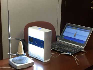 Scanning a cuneiform cone (Image courtesy of Lee Ann Potter)